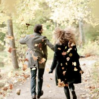 Couples playing with autumn