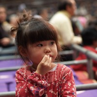 Small japanese girl watching sumo, Japan